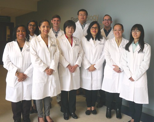 10 members of the 2017 NGL lab in white coats