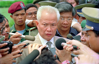 Khieu Samphan, the spokesperson for the Khmer Rouge meeting the press in Phnom Penh