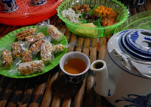 Tea with sweets at the snack factory on the Mekong River in Vietnam