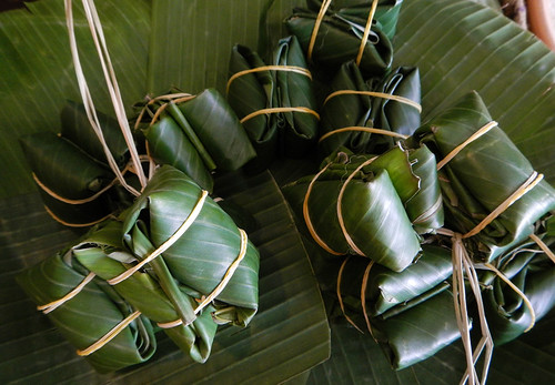 Banana-leaf-wrapped bundles of fermented pig's ear