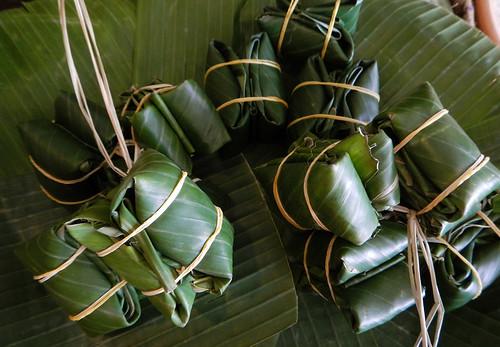 Banana-leaf-wrapped bundles of fermented pig's ear