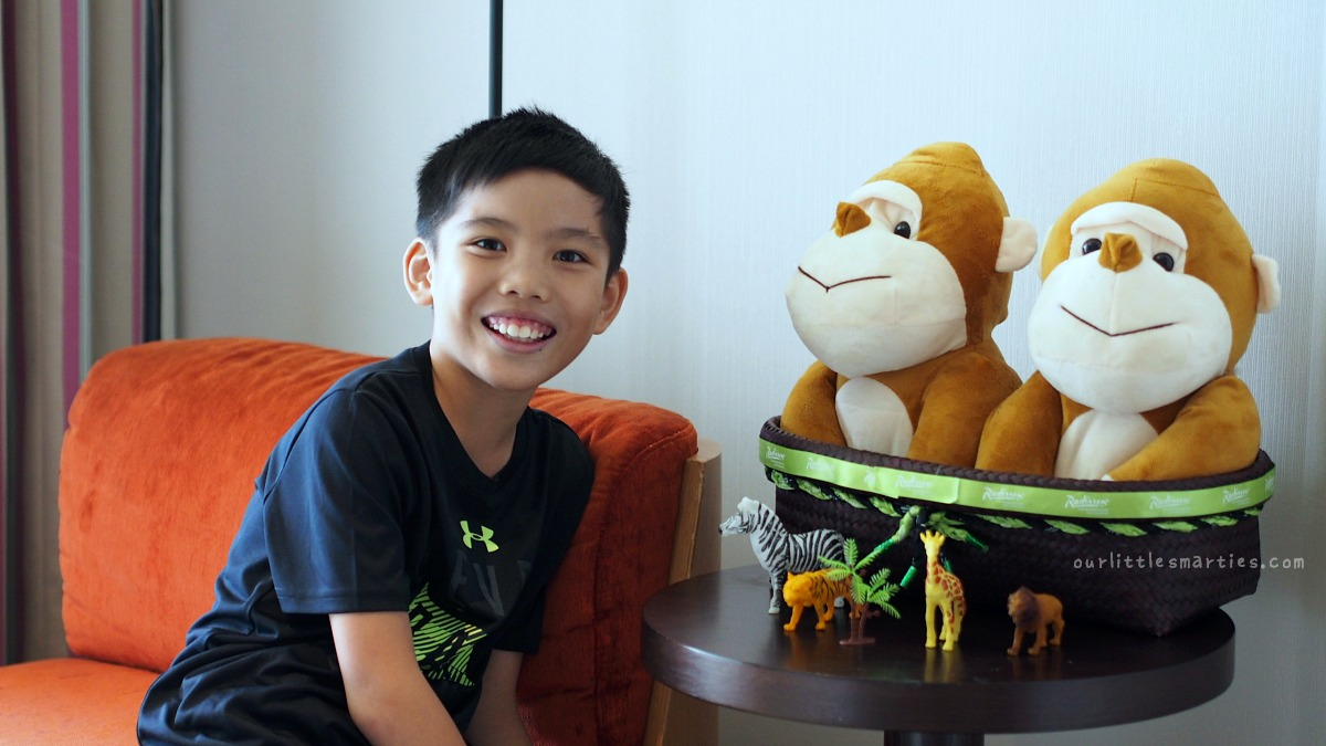"Edison with Hotel Mascot ""Mismi"" in his room"