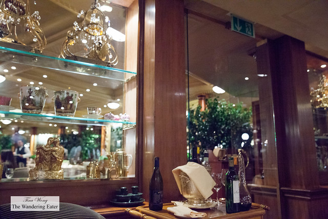 Interesting wall of objet d'art and the wine cart