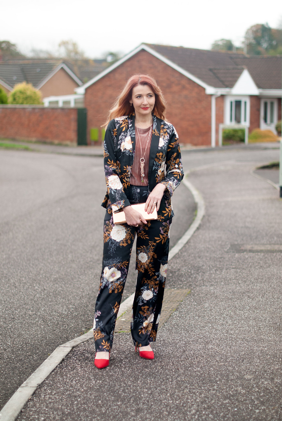 Floral pyjama pajama-style suit, Christmas party outfit: Trouser/pants suit with red heels, pink velvet top and gold mirror clutch | Not Dressed As Lamb, over 40 fashion