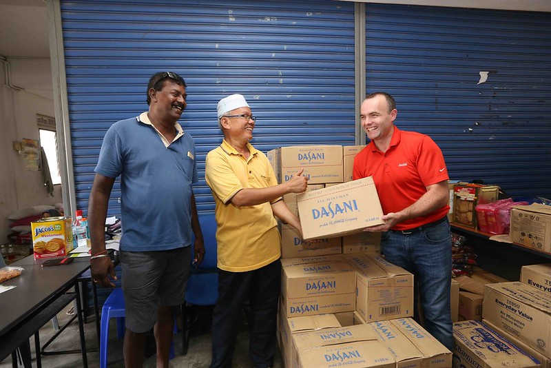 Mcgeown Hands Over Drinking Water To Representatives From The Welfare Department At The Lubok Meriam Relief Centre