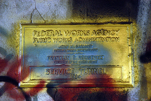 1939 dedication plaque discovered during renovations of the Free Expression Tunnel. The discovery was made below over 60 years worth of paint layers.