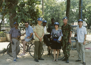 In Siam Reap - a UN data collection team - Rajish-cartographer, Serguei-leader, Major Wu-Chinese rep, Fernando-cartographer, unknown, unknown, Major Lewis-British rep, Tom -computer man.