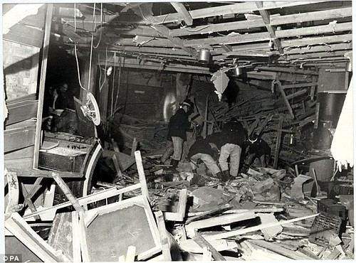 01CDC6BC0000044D-0-Rescuers_pick_through_the_rubble_after_the_explosion_which_also_-a-2_1448013335230