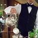 Waiter making the thyme tisane, pouring hot water into the ornate silver teapot