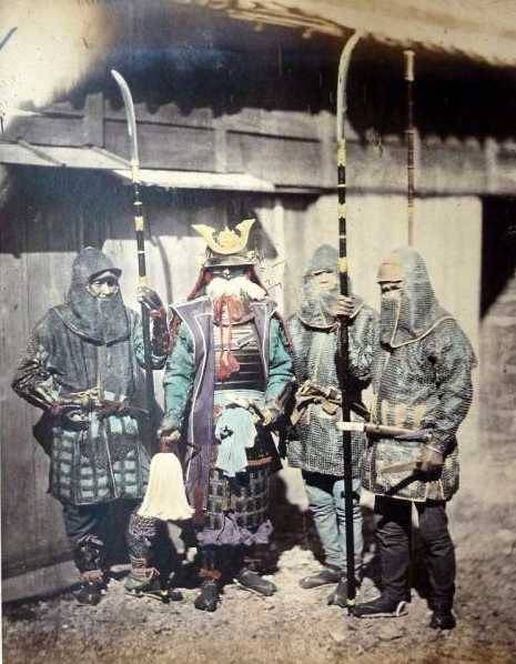A Rare Photo of a Japanese Samurai with his Retainers wearing who are wearing Kusari Katabira , with Hachi Gane and Wielding Naginata, Japan, c. 1800s