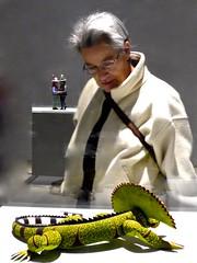 Catherine admiring Iguana wood carving, Sioux City Art Center