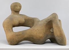 Henry Moore — Recumbent Figure, 1938. Sculpture: Green Hornton stone, 89 x 133 x 74 cm; 520 kg. Tate.  This is one of the earliest works in which Moore shows the female figure undulating like the landscape. It was commissioned by the architect Serge Cherm