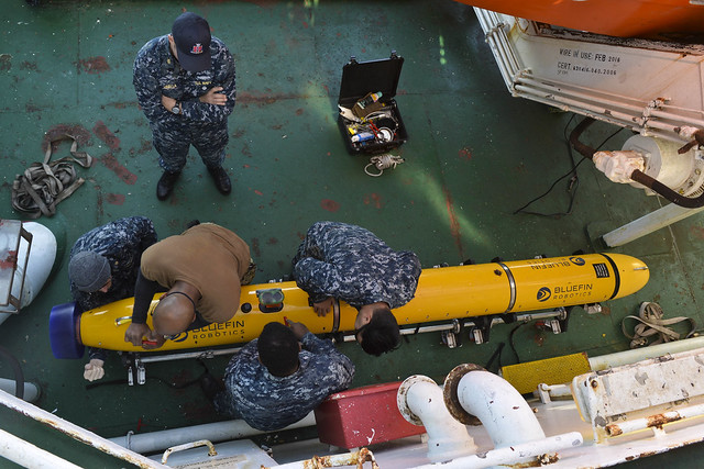 Sailors prepare underwater unmanned vehicle.