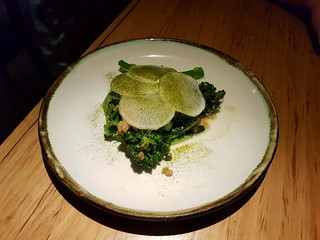Steamed broccolini, chickpea and miso butter, daikon and chive powder at Transformer