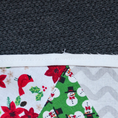 "Sew flange to quilt block with scant 1/4"" inseam."