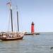 Red Witch Tall Ship with Lighthouse in Background - Kenosha, Wisconsin