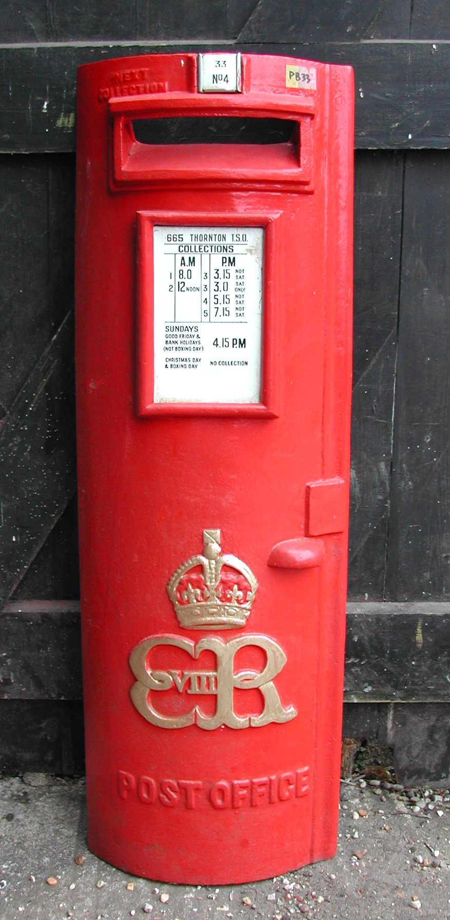 This rare Edward VIII pillar box door shows the built-in posting aperture, collection plate and the Royal cypher at Colne valley Postal History Museum, Halstead, Essex