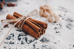 Cinnamon sticks in close up with flour background