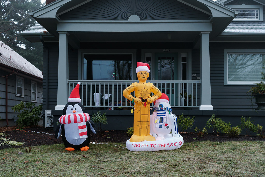 Christmas decorations of a penguin, C-3PO, and R2-D2 outside a house in the Irvington neighborhood of Portland, Oregon