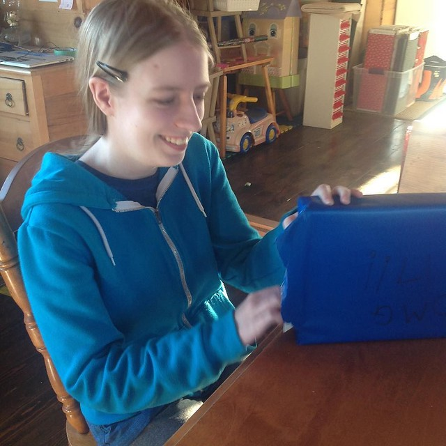 Birthday girl getting her new drawing tablet.