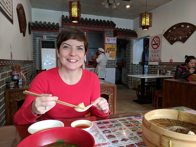 enjoying the soup dumplings