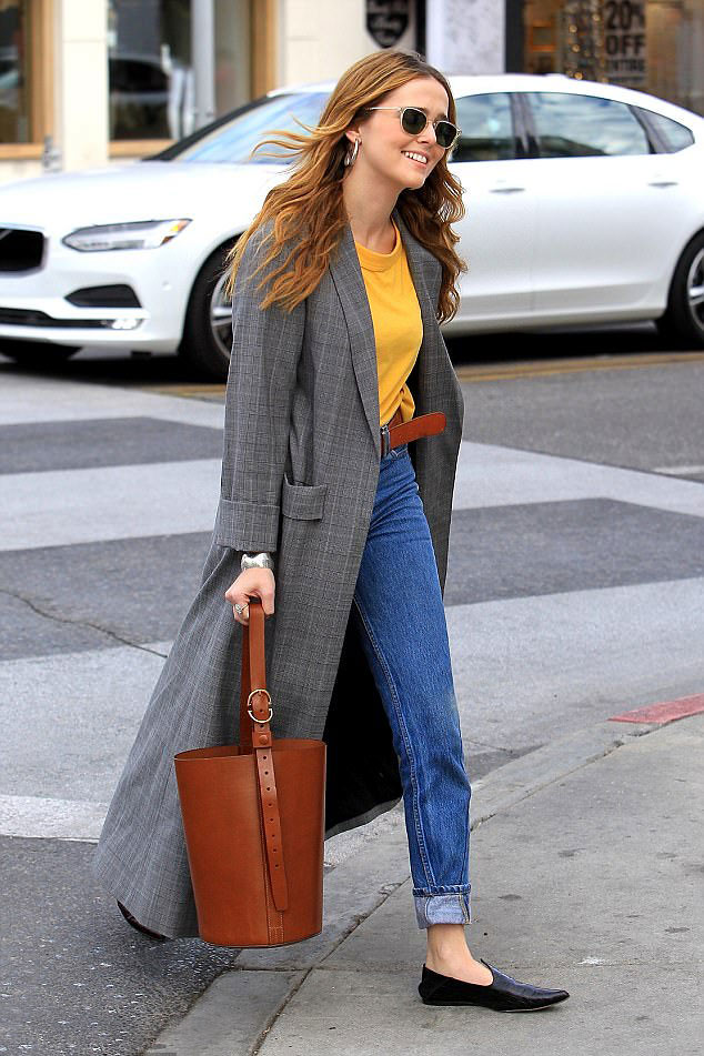 Extra long coat, Ankle length coats, long coats, long coat trend, long grey plaid trench coat, long plaid coat, long trench coat, blue-cuffed jeans, brown belt, brown bucket bag, black leather slip-on shoes, a yellow t-shirt, silver hoop earrings, sunglasses.Zoey-in-grey-plaid-maxi-coat