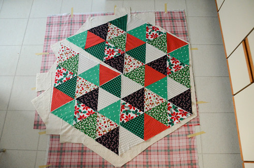 Quilt Sandwich - Place quilt top on top of batting, smooth out all wrinkles.