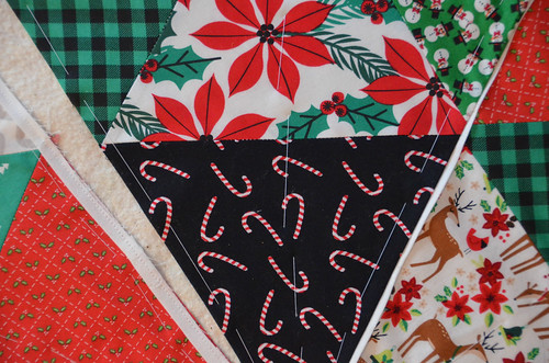 Quilt Sandwich - baste with thread, starting/sewing in opposite directions.