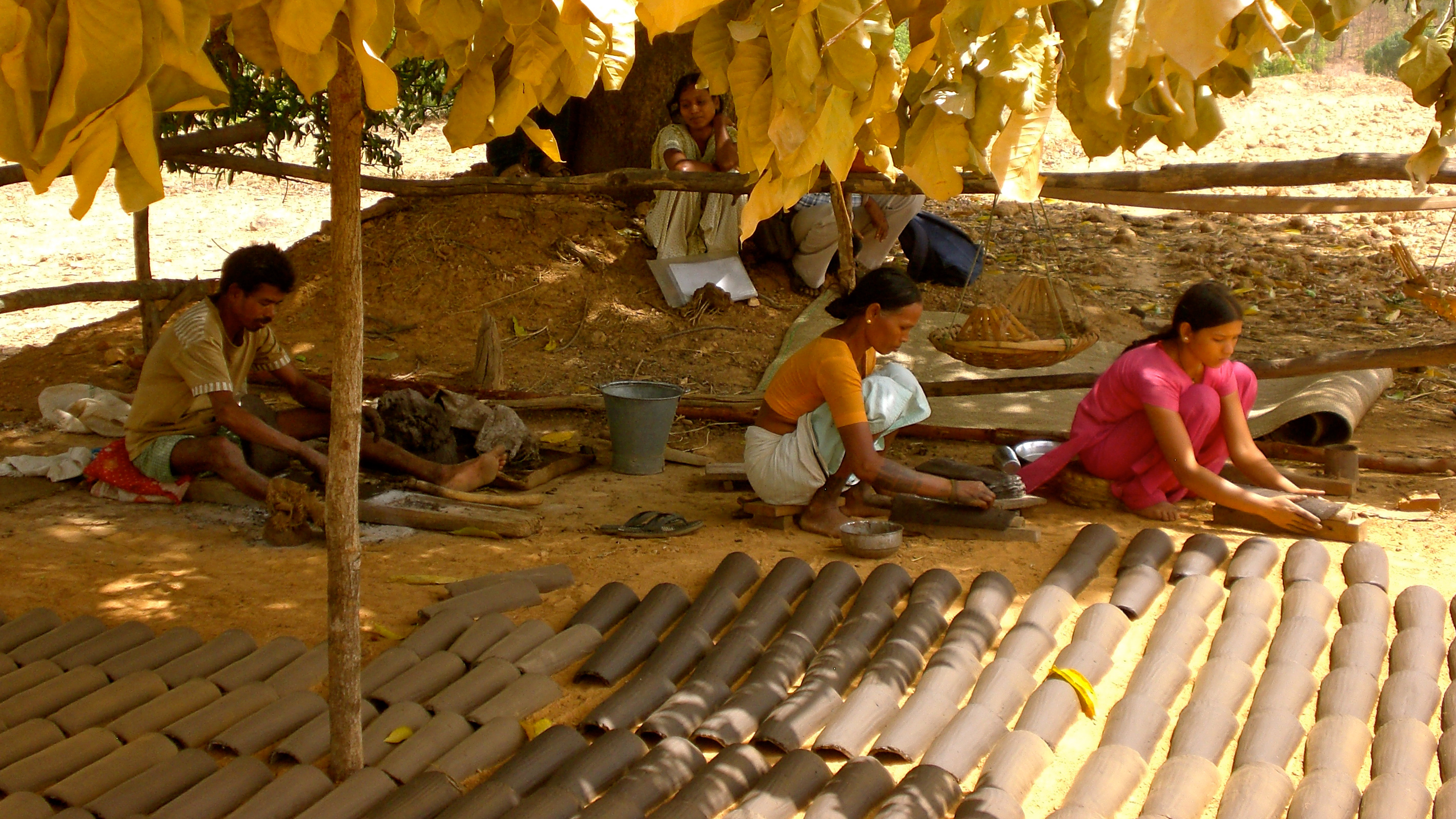 People working in a rural village