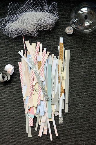 4. I like to cut enough strips to completely fill the ornament bulb, but you could also use decorative filler (ribbons, veil, scrapbook paper, etc.)