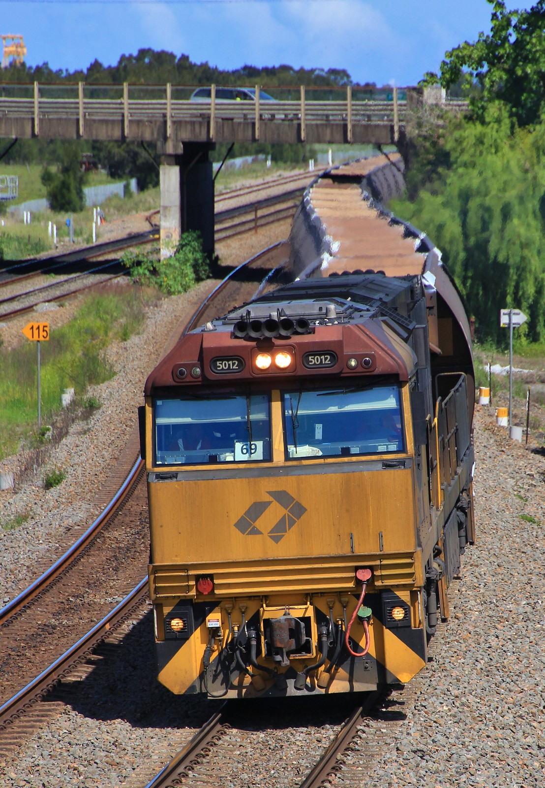 5012 leads MR953 empty coal train through Tarro to Moolarben by bukk05