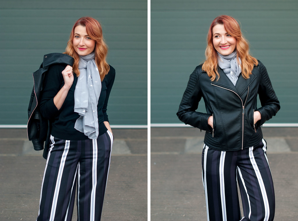 Winter to spring transitional outfit - Black biker jacket, wide leg stripe trousers, silver sneakers, grey scarf | Not Dressed As Lamb, over 40 style