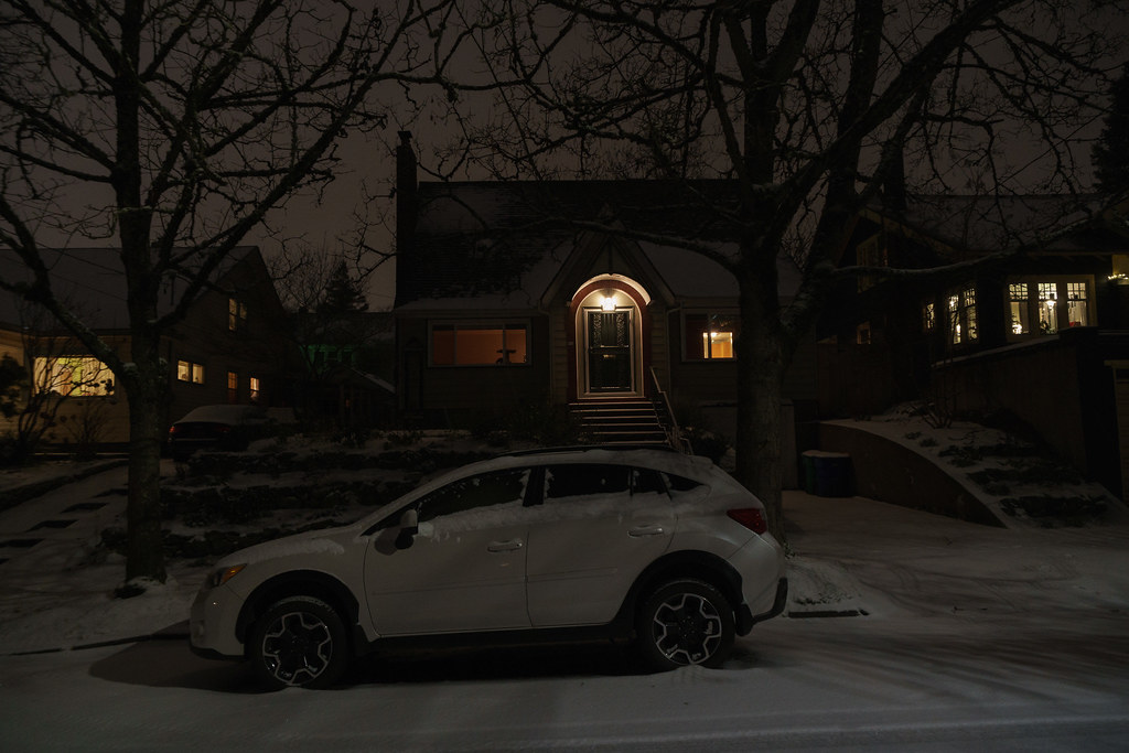 Our Subaru Crosstrek is parked in front of our house on a snowy Christmas Eve in Portland, Oregon