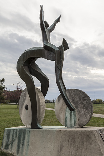 "Artist Jerome B. Meadows's 1991 sculpture, ""A Celebration of Bicycling,"" stands on the grounds of Carillon Historical Park in Dayton, Ohio, that contains historic buildings and exhibits concerning the history of technology and the history of Dayton"