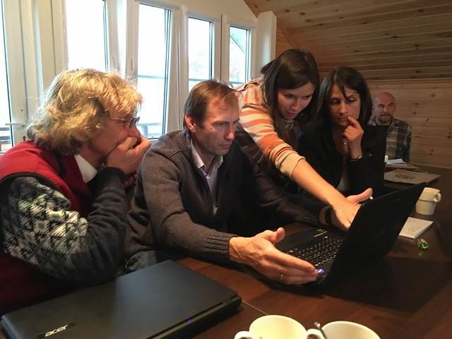 Figure 3. (L-R) Aleksei Dondua, Aleksandr Matsyna, Rada Surmach, and Katya Matsyna discuss interpretation of avian movement data. Photograph © Jonathan Slaght, WCS.