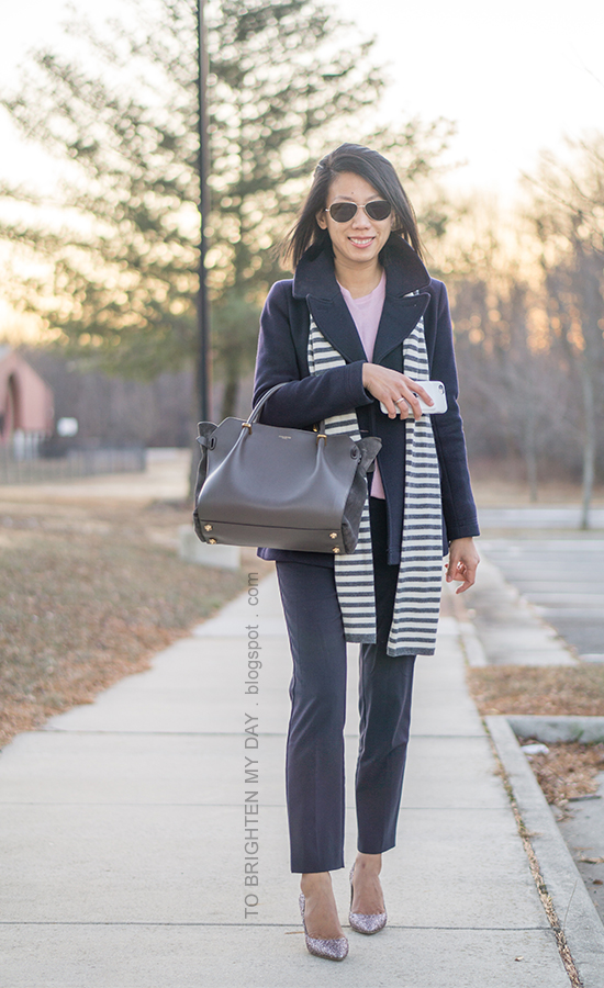 gray striped scarf, navy pea coat, navy trousers, gray tote, pink sweater, pink glitter pumps