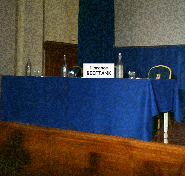 Empty press conference table, labeled BEEFTANK
