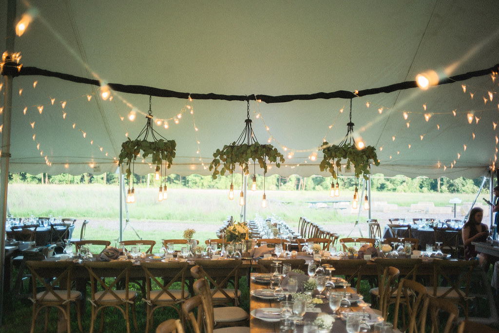 Wedding barn wood tables natural wood event table rentals iowa bistro light greenery chandeliers a junglespirit Gallery