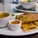 green chile and cheese dosa, with sambar, coconut and tomato chutneys