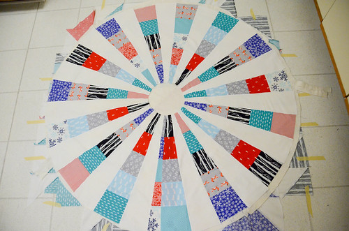 "12. Quilt sandwich: Place quilt top on top of batting - ""parachute"" method to smooth out"