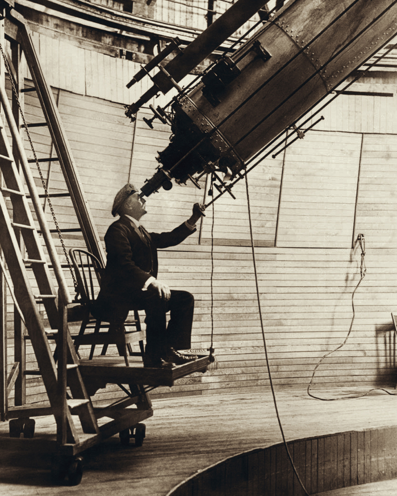 Percival Lowell, originator of the Planet X hypothesis, observing Venus in the daytime from the observer's chair of the 24-inch (61 cm) Alvan Clark & Sons refracting telescope, installed in the summer of 1896 at the Lowell Observatory, which he established in Flagstaff, Arizona. Photo taken on October 17, 1914.