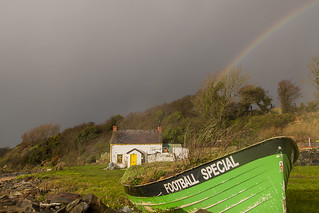 A Boat A Rainbow A Cottage