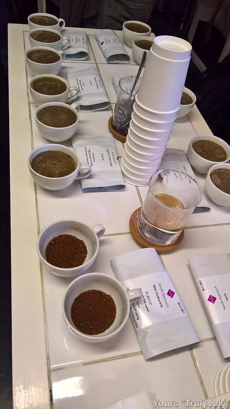 Different coffees are presented in a line of cups and freshly brewed for #CoffeeCupping.
