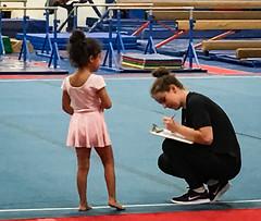 Mila getting scored on her gymnastics