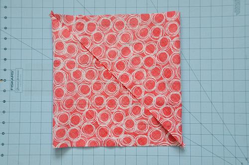 Fold upper right corner over to upper left corner.