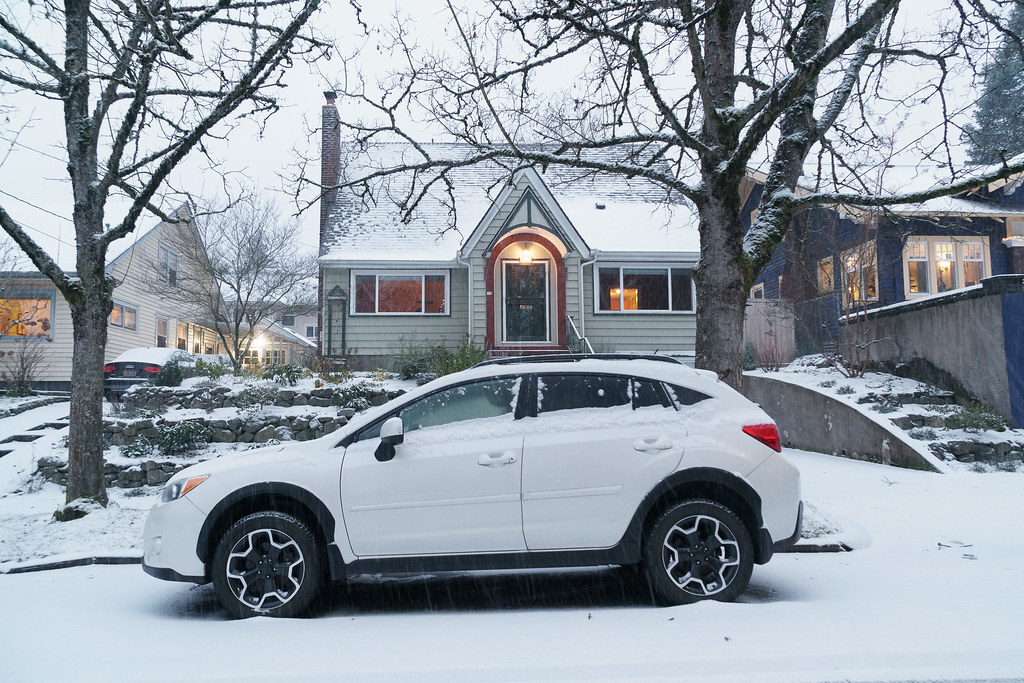 A light snow covers my car and house on Christmas Eve in Portland, Oregon
