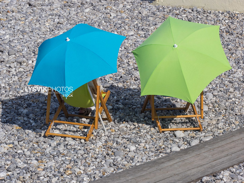 Chairs and Umbrella pebble beach Normandy