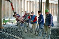 Men pour concrete
