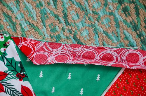 Sew the triangle down and along the edge for a few inches.