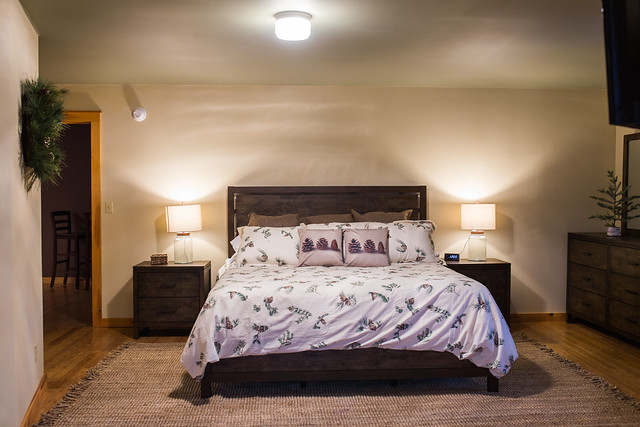 Family suite with king bed, two twin beds and private full bath with soaking tub;